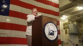 Richard Nowatzki LCDR USN (Ret) speaks to the audience on-board the USS Hornet (CV-12) museum. (Action Alameda News)